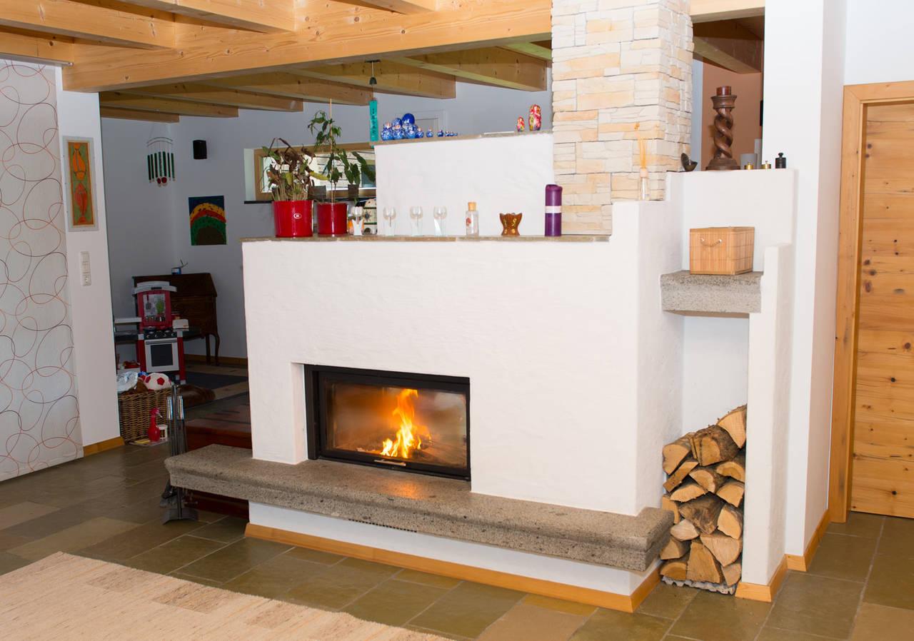 kaminofen als raumteiler raum und m beldesign inspiration. Black Bedroom Furniture Sets. Home Design Ideas